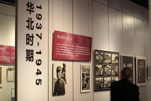 A visitor looks at photos on display at the Qian Xuesen Library and Museum.